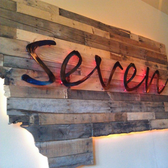 Seven. A new Lakeside MT restaurant. Clever name and sign celebrating the license plate numbering system in this gorgeous state. #food #branding #Montana