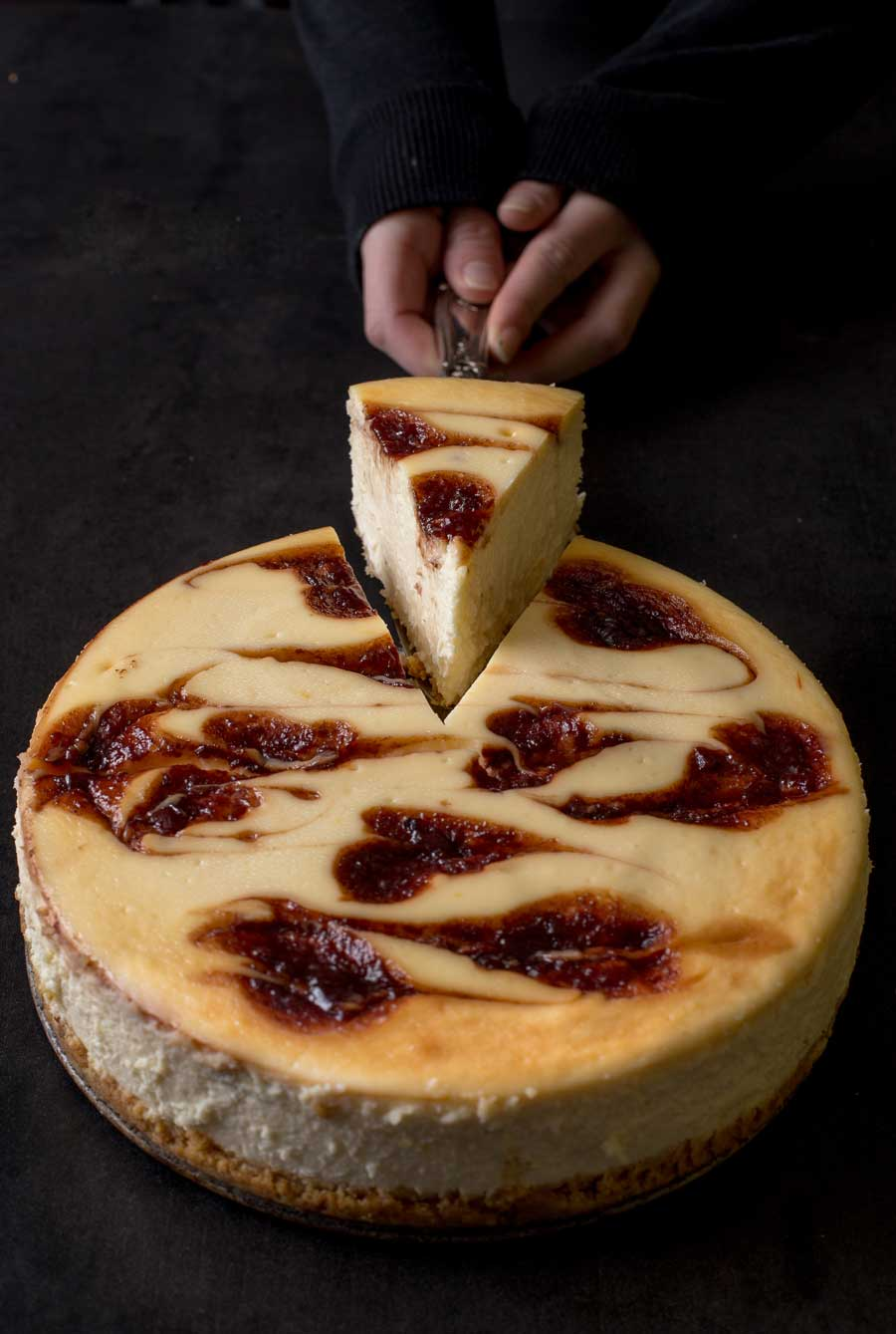 Serving a slice of habanera cheesecake.